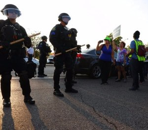 St. Louis County police say they broke up a demonstration near an upscale mall because protesters weren't listening to instructions and tried to evade two lines of officers blocking the on-ramp to a highway, Wednesday, Sept. 20, 2017, in St. Louis. (Christian Gooden/St. Louis Post-Dispatch via AP)