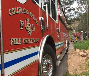 Colorado Springs firefighters approached a vehicle with possible overdose victims inside, but the driver of the vehicle rammed into the fire truck after crews backed away when they spotted a gun. (Photo/CSFD)
