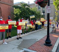 Mass. FFs hold rally to protest planned engine cut