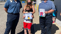 Mich. medics award boy, 7, who helped save his mom after dog attack