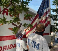 Photo of the Week: Fla. task force raises flag from floodwaters