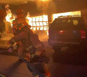 A three-bay garage fire was well-involved and venting through the roof of the building when members arrived on scene.