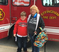 Ill. boy, 11, receives award after calling 911 for mom