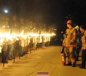 This photo shows traditional flambeauxs at the Mardi Gras parade in 2016. New Orleans Fire Department officials have announced that NOFD fire trucks will not be in this year's parade, as a labor battle between the city's fire union and city officials continues. (Photo/New Orleans Fire Department Facebook)
