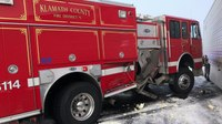 Ore. fire engine, police vehicles struck twice at crash scene
