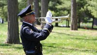 Video: Cop tends to memorial of woman killed in crash 20 years ago