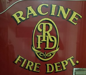 Racine firefighters are planning to take the city to court over cuts to benefits after arbitrators ruled against them.