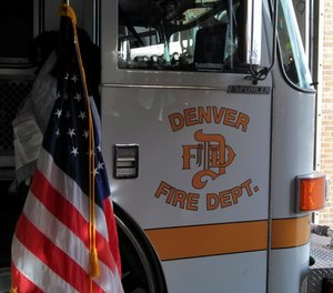 The city of Denver will pay $100,000 to a firefighter who was secretly filmed by a a former lieutenant who placed a hidden camera in her bedroom.