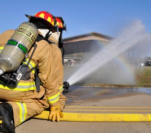 The latest quantum leap in protecting firefighter health occurred when the department took delivery of one of two new pumpers that were specifically designed to accommodate the committee's biggest recommendation to date: personnel wait until they arrived on scene to don their PPE and SCBA. (Photo/DoD)
