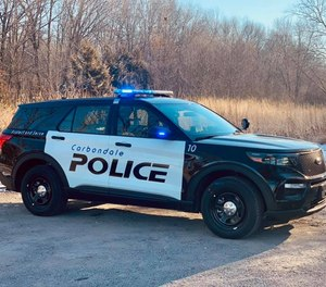 Carbondale police officers were praised for transporting a shooting victim in a pickup truck and performing CPR in the bed of the truck en route to the hospital.