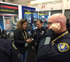 You can feel and hear the difference of these earpieces. An officer tries out Earphone Connection at a trade show.
