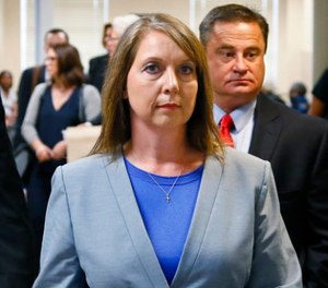 Betty Shelby leaves the courtroom with her husband, Dave Shelby, right, after the jury in her case began deliberations in Tulsa, Okla., Wednesday, May 17, 2017. (AP Photo/Sue Ogrocki)