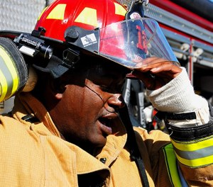 A firefighter removes his helmet after the completion of an exercise at Dobbins Air Reserve Base, Ga. (U.S. Air Force photo/Senior Airman Andrew Park)