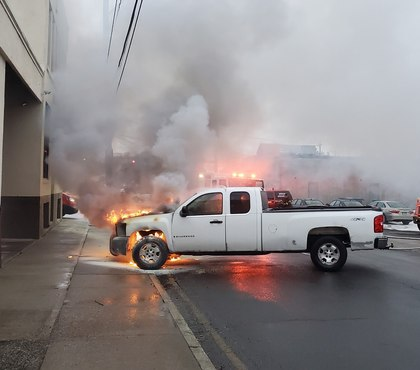 Off-duty Conn. assistant fire chief removes burning truck from workplace building