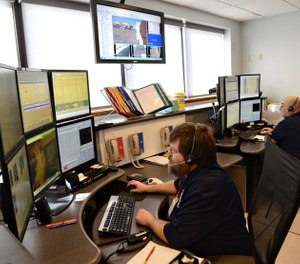 Each emergency in Cass County begins with a 911 call received by a headset-clad dispatcher before an array of computer monitors in a downtown Logansport office. (Photo/ Air Force by Kelly White)