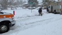 Neighbors team up to dig out Denver Health ambulance stuck in snow