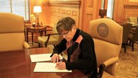 Kan. governor signs bill designating 911 dispatchers as emergency responders