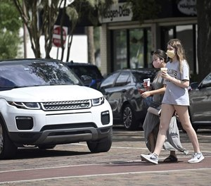 Pedestrians walk through the downtown shopping district in Winter Park, Florida, in September. Pedestrian fatalities have risen during the COVID-19 pandemic.