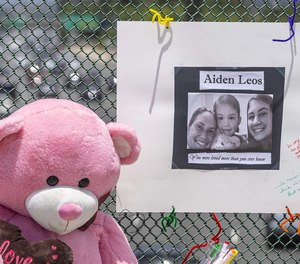 A stuffed bear and a poster memorialize a 6-year-old Orange County, California, boy who was shot and killed during a road rage attack in May. Police in some areas say they've seen road rage incidents spike during the COVID-19 pandemic.