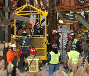 The fourth group of workers emerge from an elevator after they were stuck overnight in a shaft at the Cayuga Salt Mine in Lansing, N.Y.  (Simon Wheeler/The Ithaca Journal via AP, Pool)