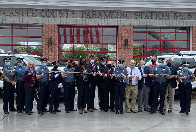 Paramedics from Station 5 join local dignitaries for the ribbon cutting ceremony.