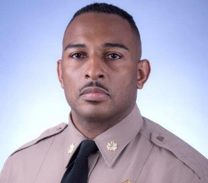 Maj. Ricky Carter was injured after crashing into a guardrail on a highway.