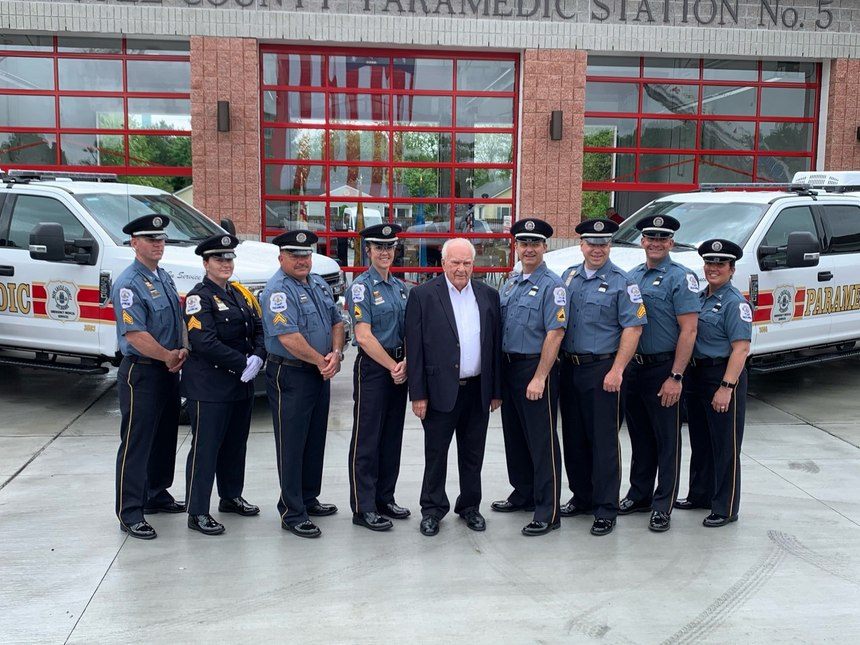 RetiredLt.John B. Potter (center) with all eight New Castle County paramedics who will work from the new Paramedic Station 5.