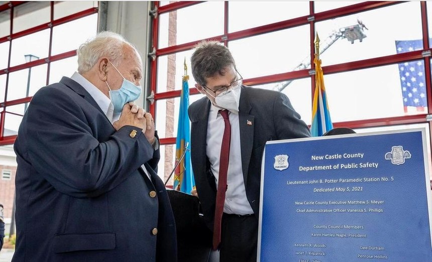 """The dedication plaque for """"John B. Potter Paramedic Station 5"""" is unveiled by Potter (left) and New Castle County Executive Matthew Meyer."""