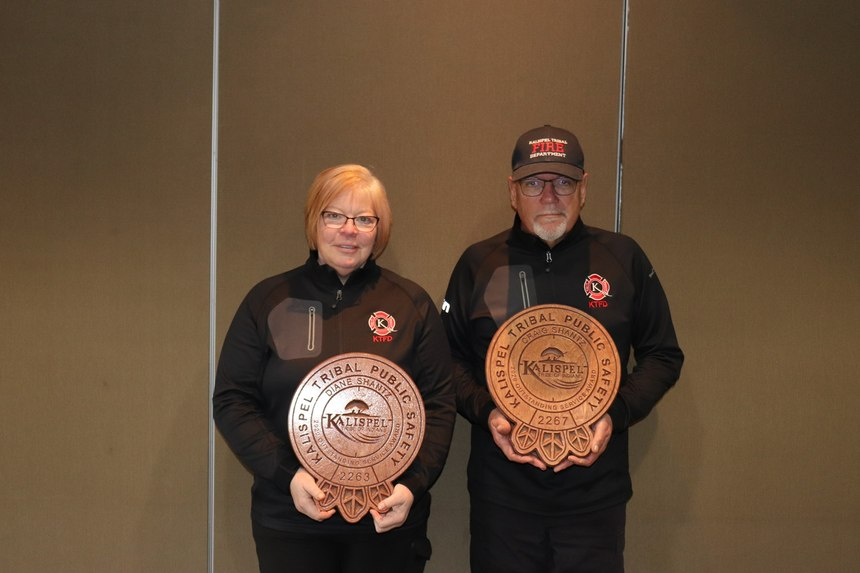 Dianne (left) and Craig Shantz accept Outstanding Service Awards from the Kalispel Tribe Fire Department.
