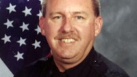 Gang member charged with killing Calif. officer