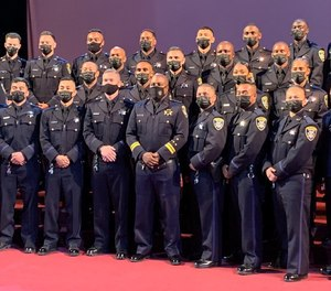 New Oakland police officers graduate from the police academy on May 28, 2021.