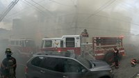 13 NY firefighters injured in blaze that spread to 4 rowhomes