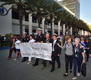 Anaheim Fire & Rescue officials and members of the Phoenix Society participate in a remembrance walk at the Anaheim Convention Center on Wednesday, Oct. 2.
