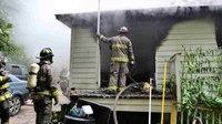 Ga. firefighter hospitalized after battling house fire