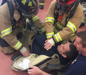 This photo shows Dalton firefighters training to perform CPR on a downed firefighter. The Dalton Fire Department hopes to have all 85 firefighters certified as EMTs by 2023. (Photo/City of Dalton Fire Department Facebook)