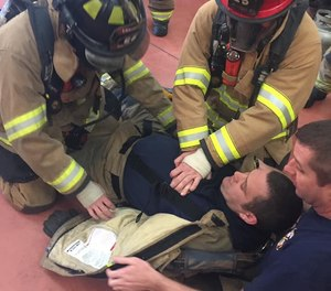 This photo shows Dalton firefighters training to perform CPR on a downed firefighter. The Dalton Fire Department hopes to have all 85 firefighters certified as EMTs by 2023.
