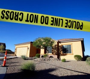 This Oct. 2, 2017 file photo shows police tape blocking off the home of Stephen Craig Paddock in Mesquite, Nev. (AP Photo/Chris Carlson, File)
