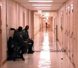 COs keep watch in a hallway on the second floor of the Mecklenburg County Jail in Charlotte, North Carolina. Kyle Harris had served as a detention officer with the facility since August 2017.