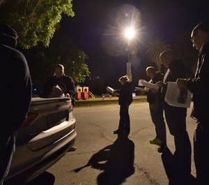 Officers from Fontana PD's child exploitation team gather at Elmer Digneo Park in Loma Linda at 4:30 a.m. to coordinate before serving a search warrant at the home of a person suspected of collecting and distributing images of child pornography. (Photo/Steven Georges/Behind the Badge)