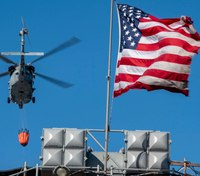 Photo of the Week: Old Glory still flies during massive fire on USS Bonhomme Richard