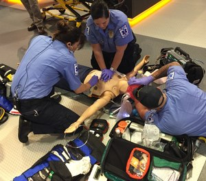 EMS personnel complete a hands-on training simulation on a protocol update.