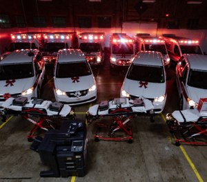 The owners of Spirit Medical Transport, LLC surprised employees with 10 new vehicles, three new power cots, four new patient ventilators, two new copiers, seven new computers and more at the service's annual Christmas party this past weekend. (Photo/Spirit Medical Transport, LLC)