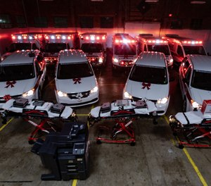 The owners of Spirit Medical Transport, LLC surprised employees with 10 new vehicles, three new power cots, four new patient ventilators, two new copiers, seven new computers and more at the service's annual Christmas party this past weekend.