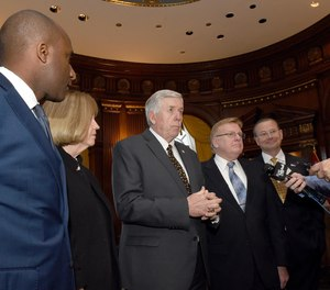 Governor Mike Parson, center, takes questions from the media with, from left, Kansas City Mayor Quinton Lucas, St. Louis Mayor Lyda Krewson, Parson, Springfield Mayor Ken McClure and Columbia Mayor Brian Treece at the Governor's Office in the Capitol building.
