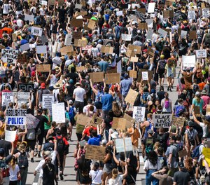 Demonstrators shut down a highway in both directions as they demand justice for Elijah McClain on June 27, 2020 in Aurora, Colorado.