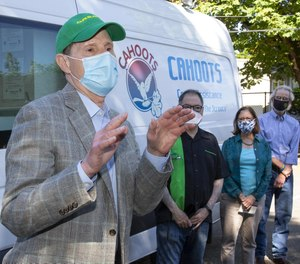 Eugene, Oregon's CAHOOTS program, which sends behavioral health workers to mental health emergency calls instead of police, has inspired a push for federal funding for similar programs in other communities. Sen. Ron Wyden (left) is sponsoring the Cahoots Act in Congress.