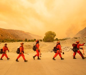 Inmate firefighters arrive at a 2020 fire scene in California.