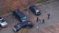 Homicide suspect killed, officer wounded in Md. police shootout