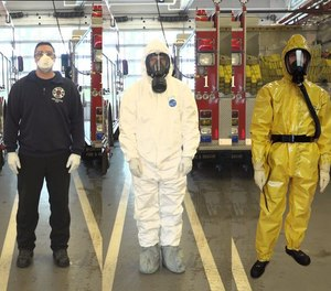In March, Portland Fire & Rescue firefighters moved to the full air filter mask, as worn by the firefighter in the white suit, on medical calls when firefighters have close encounters with a potential patient. They wear the yellow suit when they suspect someone has coronavirus symptoms.