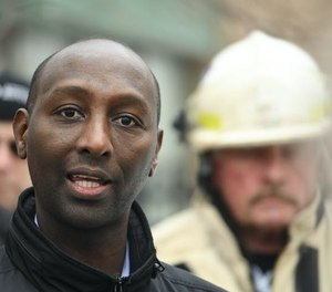 Rep. Mohamud Noor, DFL-Minneapolis, pictured after a fatal November 2019 fire, plans to renew efforts to require property owners to add sprinklers to most high-rise buildings.